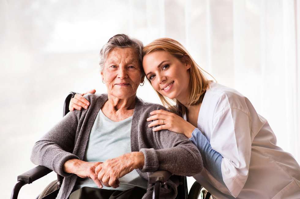 Elderly lady with carer